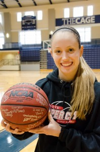 Segarra holding the signed ball in honor of her 1,000 point career