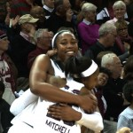 Sophomore Tiffany Mitchell and Freshman Alaina Coates hug as they start to celebrate being SEC Champs.