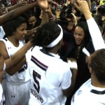 Head Coach Dawn Staley celebrates an SEC Championship with her players.