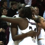 Sophomore Aleighsa Welch hugs Junior Elem Ibiam as they begin to celebrate an SEC Championship.