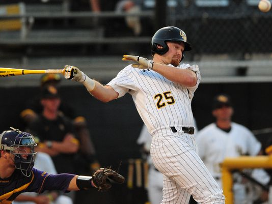 Southern Miss' Mason Robbins (25) hits a foul ball Wednesday night as the Golden Eagles face East Carolina in the opening round of the Conference USA baseball tournament at Pete Taylor Park. (Photo: Kelly Price/Hattiesburg American)