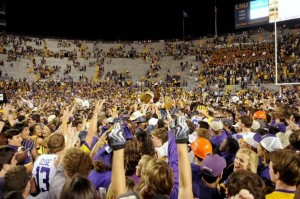 LSU fans storm the field after a huge victory over #3 ranked Ole Miss Saturday night.