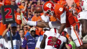 Deshaun Watson hurdles a NCST defender on the way to a touchdown
