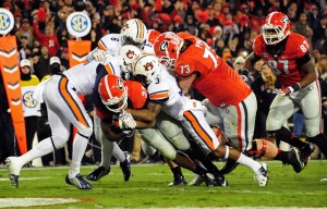 Nick Chubb carries the ball for a second quarter touchdown against the Tigers. The freshmen phenom will now become the #1 guy in Georgia's backfield due to Todd Gurley's season-ending injury. Image via Heavy.com