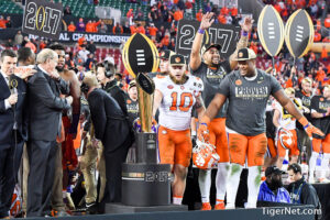 Ben Boulware and Carlos Watkins eye the College Football Playoff Trophy after Clemson's 35-31 win over Alabama. Photo credit to Tigernet.com